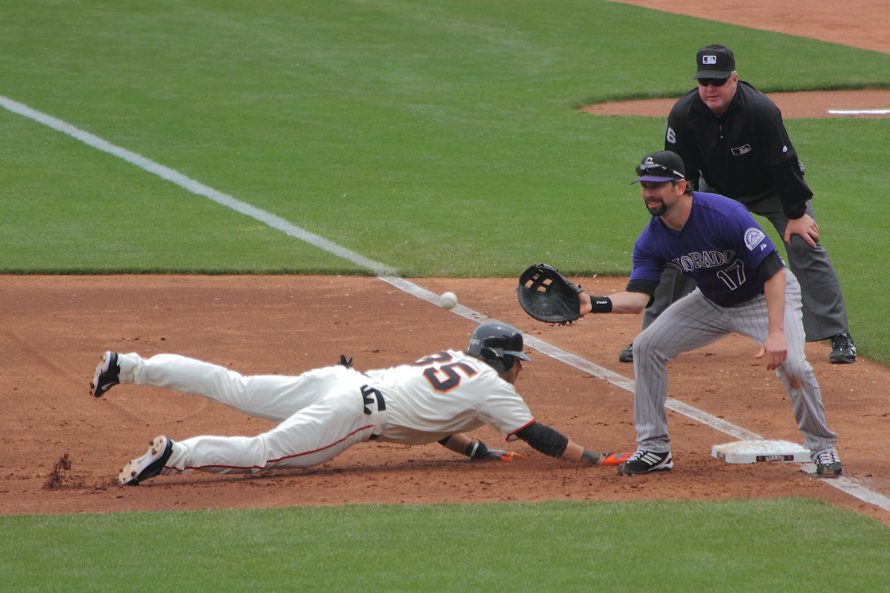 Crawford gets back, with Todd Helton holding him on.