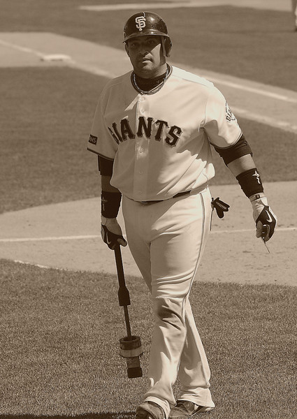 Bengie Molina - the only man to have won a World Series ring even though he played for the losing team in the Series in 2010.  Sepia tone.