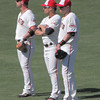 Aaron Rowand, Andres Torres and Nate Schierholtz wait out a pitching change.
