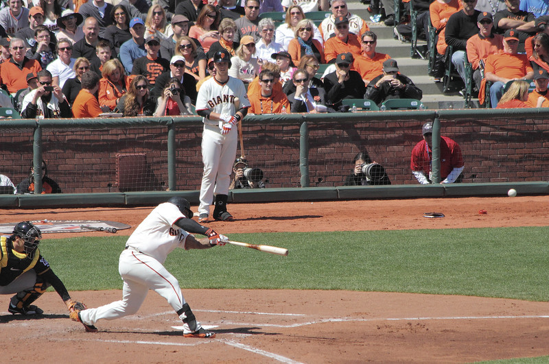 Pablo Sandoval reaches down and pokes a single into left field.