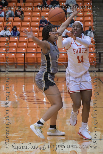 #11 SGP guard Jahcelyn Hartfield makes a pass up court on a fast break.