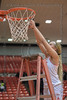 #1 SGP guard Kendall McGruder takes her turn cutting the net after the Warriors regional playoff win over Plano East.