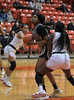#42 Plano East Forward Idara Udo eyes the basket as she attempts to score.  Defending is #5 SGP Center Nxerro Maluw