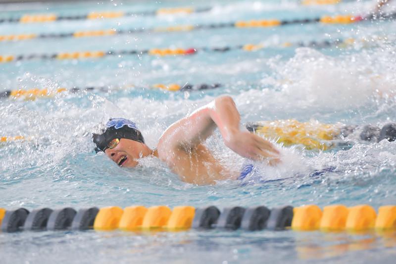 Ashleigh Snoozy   The Sheridan Press<br>Sheridan's Bryson Shosten swims through the last 100 meters of the boys 400-meter freestyle relay at Sheridan Junior High School Saturday, Jan. 11, 2020.