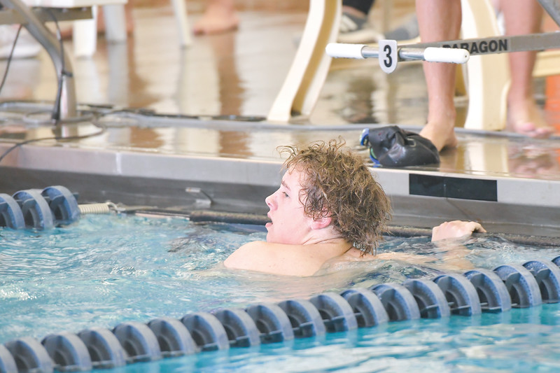 Ashleigh Snoozy | The Sheridan Press<br>Sheridan's Bryson Shosten looks back at the scoreboard to check rankings after completing the last leg of the boys 400-meter freestyle relay at Sheridan Junior High School Saturday, Jan. 11, 2020.