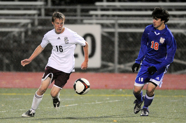Silver Creek's Ryan Hanratty (left) and Centaurus' Cameron Trezoglou (right) chase down the ball during their soccer game at Everly Montgomery Stadium at Longmont High School in Longmont, Colorado October 27, 2009. CAMERA/Mark Leffingwell