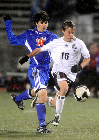 Silver Creek's Ryan Hanratty (right) beats Centaurus' Cameron Trezoglou (left) to the ball during their soccer game at Everly Montgomery Stadium at Longmont High School in Longmont, Colorado October 27, 2009. CAMERA/Mark Leffingwell