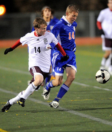 Silver Creek's Brian Hardy (left) and Centaurus' Sam Esler (right) compete for the ball during their soccer game at Everly Montgomery Stadium at Longmont High School in Longmont, Colorado October 27, 2009. CAMERA/Mark Leffingwell