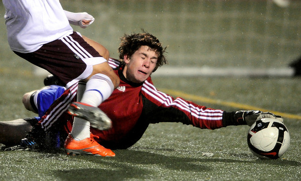 Centaurus' Victor Hernandez (right) deflects a shot from Silver Creek's Buddy Martine (left) during their soccer game at Everly Montgomery Stadium at Longmont High School in Longmont, Colorado October 27, 2009. CAMERA/Mark Leffingwell