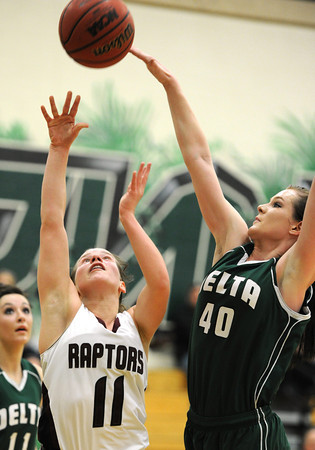 20120224_BKOI_22.jpg Silver Creek High School's Ana Gurau (No. 11) tries to put up a shot past Delta High School's Callie Gafford (No. 40) during the second quarter Friday, Feb. 24, 2012 at D'Evelyn High School. The Raptors were defeated by the Panthers, 50-47.<br /> (Matthew Jonas/Times-Call)