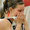 20120224_BKOI_239.jpg Silver Creek High School's Ana Gurau (No. 11) reacts to being defeated by Delta High School Friday, Feb. 24, 2012 at D'Evelyn High School. The Raptors were defeated by the Panthers, 50-47.<br /> (Matthew Jonas/Times-Call)
