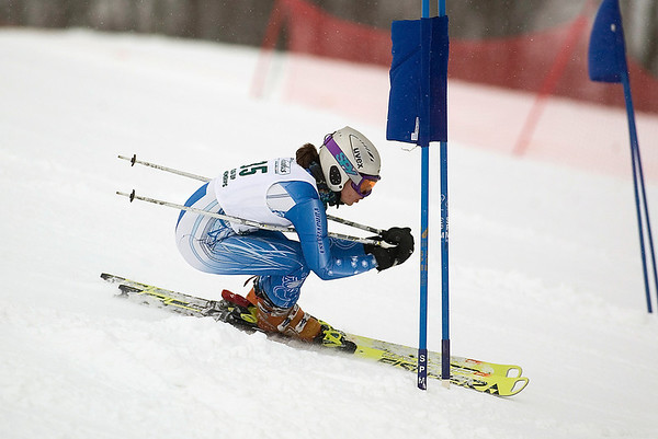 Record-Eagle/Jan-Michael Stump<br /> Traverse City Central's Sierra Olsen runs the giant slalom in the state finals Monday at Boyne Highlands.