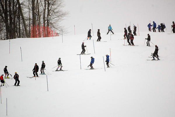 Record-Eagle/Jan-Michael Stump<br /> Skiers, coaches and organizers check the slalom course during the boys and girls downhill skiing state finals Monday at Boyne Highlands.