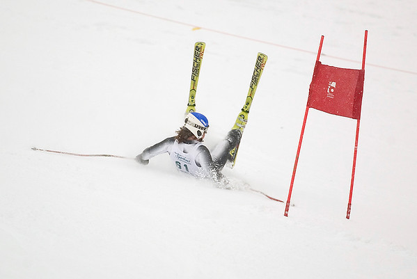 Record-Eagle/Jan-Michael Stump<br /> Traverse City West's Charlie Hornbogen falls during a giant slalom run in the  state finals Monday at Boyne Highlands.