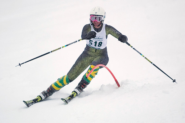 Record-Eagle/Jan-Michael Stump<br /> Traverse City West's Nicole Schroeder runs the slalom in the  state finals Monday at Boyne Highlands.