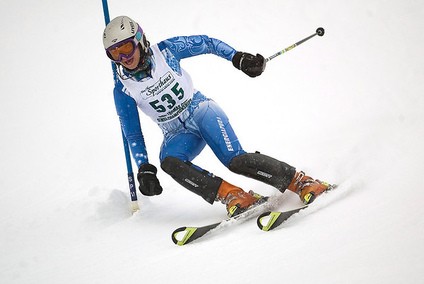 Record-Eagle/Jan-Michael Stump<br /> Traverse City Central's Sierra Olsen runs the slalom in the  state finals Monday at Boyne Highlands.