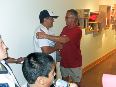 Coach Rivera runs into his former San Marcos High School Coach while touring the Aztec Athletic Facility.