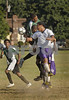 L-R #4 Elmont Justin Mathew, #14 Elmont in air, Aaron Dennis (white shoes)Sewanhaka #36, in air