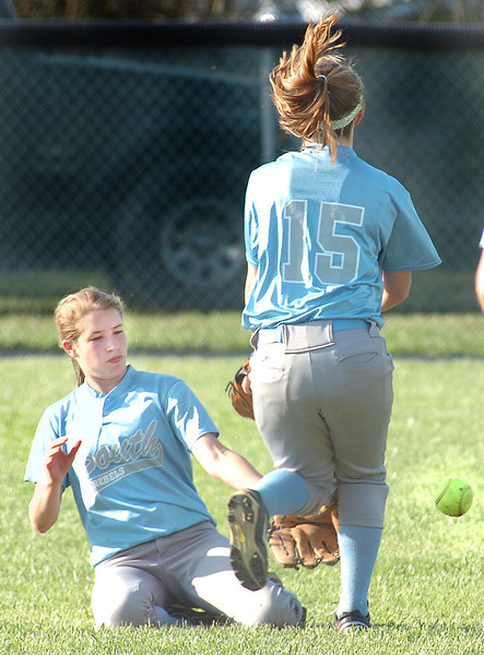 Sullivan South's right fielder, #1, Gina Jones, and second base #15, Ashley Luster, narrowly avoid running into each other while going after fly ball, which fell in. Photo by Ned Jilton II