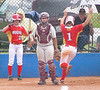Daniel Boone's #1, Meredith Good, throws up her arms in celebration as she scores while D-B catcher, Cydnee Morrisette, #38, still waits for a throw. Photo by Ned Jilton II