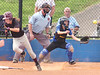 Dobyns Bennett's #19, Makaylah Darnell, heads to first while Volunteer catcher #11, Kellie Kirk, scrambles after the ball while the home plate umpire watches for fair or foul. Photo by Ned Jilton II