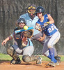Gate City's #22, Emily Baker, lays down a bunt while Sullivan South's catcher #8, Sidney Neil, covers the plate. Photo by Ned Jilton II