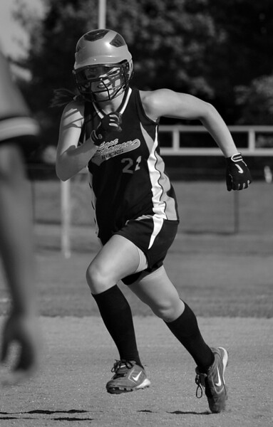 #21 Kelly Humes, 1B, heads to 3B. Photo by Kathy Leistner.