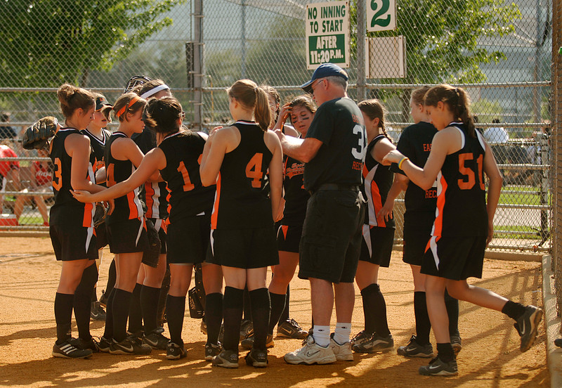 Coach Joe Lores with his team. Photo by Kathy Leistner