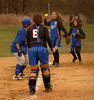 MHS catcher #6 N. Zimmerman, #5 V. Puma, #4 Jessica Bierd, and #9 Rachel Wakeford, trap a Roosevelt runner heading to home plate. Malverne HS vs Roosevelt HS, April 14th, 2007, MHS lost 6-30 and are 0-2. Photo by Kathy Leistner.
