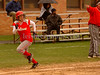 #9 VSSHS Connie Mottola heads to home plate with coach Dom pointing the way. . VSSHS vs Friends Academy. April 17th, 2007. Photo by Kathy Leistner