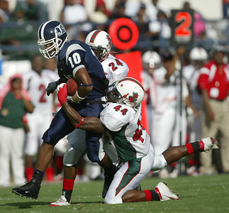 Jackson State receiver Kethonne Mclaurin (10) is pulled down from behind by MVSU defenders Jean-Pierre Marshall, left, and Tyler Knight, right. (Charles A. Smith/Special to the Herald)