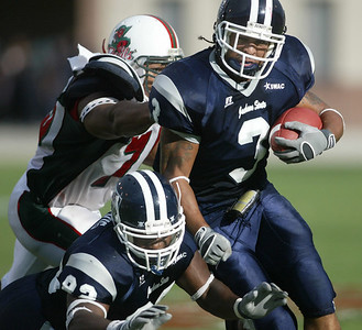 Jackson State running back Erik Haw runs for a first down as Miss. Valley defender John Price attempts to bring him down. (Charles A. Smith/Special to the Herald)