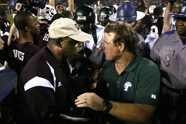 First year Mississippi State coach Slyvester Croom, left, accepts congratulations from Tulane coach Chris Scelfo, right, after Mississippi State logged their first victory 28-7, Saturday, September 4, 2004 in Starkville, Miss. (AP Photo/Charles Smith)