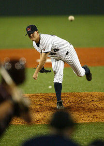 Ole Miss pitcher Eric Fowler throws a strike in the fist inning. (Charles A. Smith/Special to the Journal)