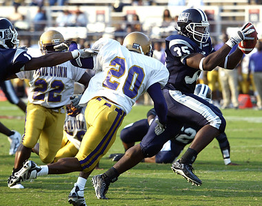 Jackson State running back David Kennebrew, right, darts past the outstretched arms of Paul Quinn defender Damien Gary for an easy touchdown during the first half of the game, Saturday, September 2, 2006 in Jackson, Miss. Jackson State defeated Paul Quinn 44-20. (AP Photo/Charles Smith)