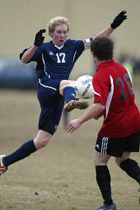 Pearl forward Aaron Thornton, left,  driblbles past Florence defender Orie Shorter. (Charles A. Smith/Special to the Ledger)