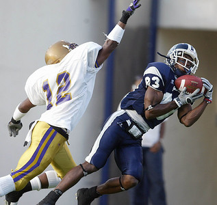 Jackson State receiver Jaymar Johnson hauls in a long pass over Paul Quinn unidentified defender during the first half, Saturday, September 2, 2006 in Jackson, Miss. Jackson State defeated Paul Quinn 44-20. (AP Photo/Charles Smith)