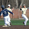 Haverhill second baseman Juanel Oriach tosses the ball to Sean Doherty for the force out on Lawrence's Elvis Peralta.