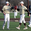 Haverhill pitcher Evan Penney is congratulated by teammate Sean Doherty after a three up, three down inning.