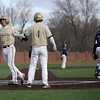 Haverhill's Tom Maguire (4) congratulates teammate Patrick Yale (5) after they both scored on a hit.