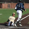 Haverhill's Juanel Oriach slides into home for a run as Lawrence catcher Jordaly Vazquez waits for the throw.