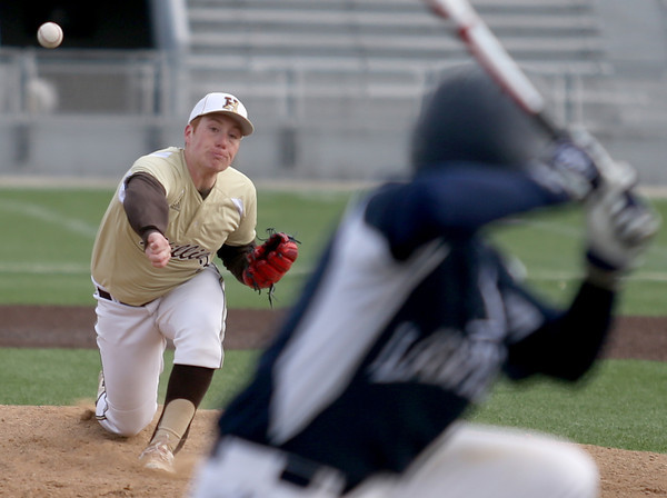 Haverhill pitcher Evan Penney delivers to a Lawrence batter during their game in Haverhill.