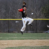 North Andover's short stop, captain Matthew Varoutsos leaps to catch the high throw and tag out Lawrence's Elvis Peralta at second base in Friday baseball action. 4/11/2014.