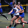 CARL RUSSO/Staff photo. Central Catholic defeated Methuen 15-5 in Girls Lacrosse Division I North First Round Tuesday night. Central's senior captain, Kelly Daigle, left and Methuen's Nicole hering battle for the loose ball. 5/27/2014.