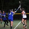 CARL RUSSO/Staff photo. Central Catholic defeated Methuen 15-5 in Girls Lacrosse Division I North First Round Tuesday night. Central's senior captain, Kelly Daigle shoots over Methuen's Samantha McGovern and Aryanna Poirier, 9, to score Central's 11th. goal. 5/27/2104.