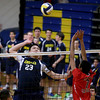Andover's Adam Yee cocks his arm for the spike against Central Catholic's Vishal Patel.