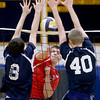 The net aids the blocking efforts for Andover's Alec Dean (8) and Kenny Doherty (40) on a spike attempt by Central Catholic's Nick Cambio.