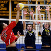 ndover's Kyle Surehan (6) and Kenny Doherty (40) leap to block a spike attempt by Central Catholic's Yeraldo Rodriguez.