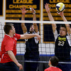 Andover's Adam Yee leaps to block a spike attempt by Central Catholic's Nick Cambio.