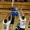 Methuen's Tim Galloway-Burke spikes the ball past Central Catholic players Nick Cambio and Nick Boes.
